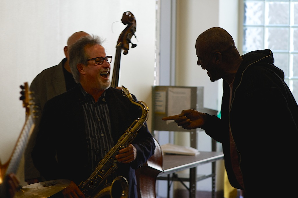 Midnight Mission Los Angeles Street Symphony Jazz Concert 9 Chuck Manning laughing with audience member
